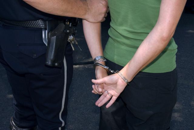 Demo_arrest_handcuffed